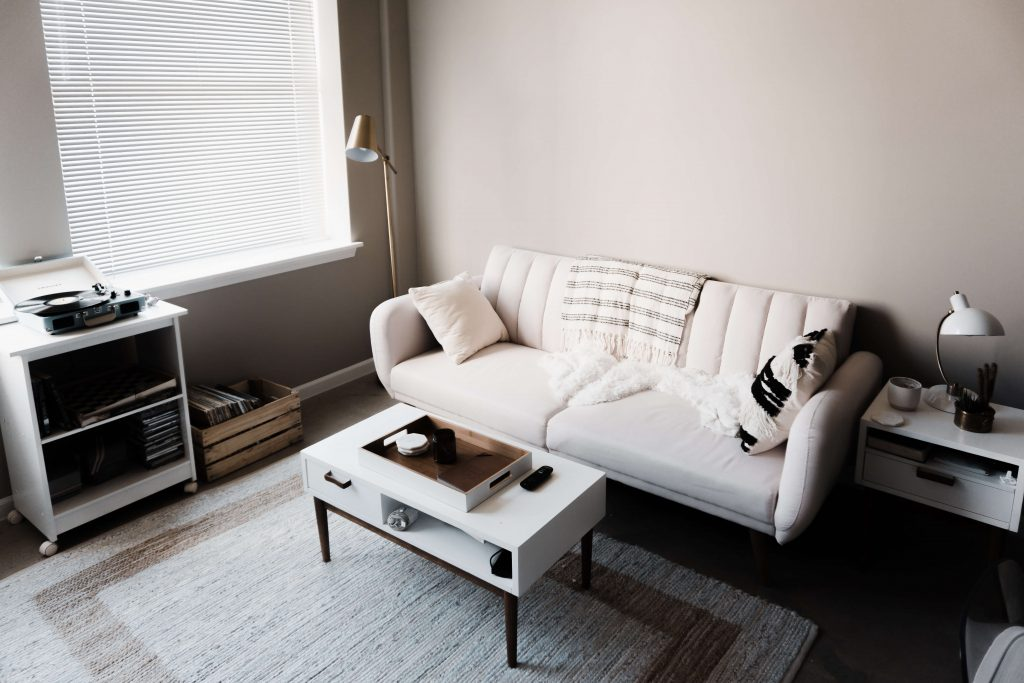 Living room with white couch and furniture cleaned