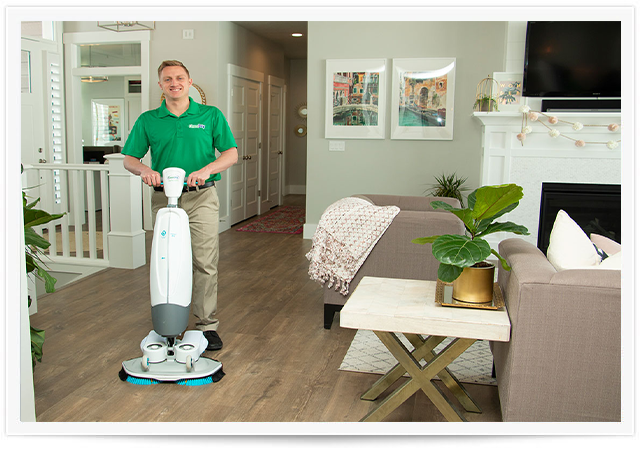 chem-dry tech performing a wood floor cleaning in slc