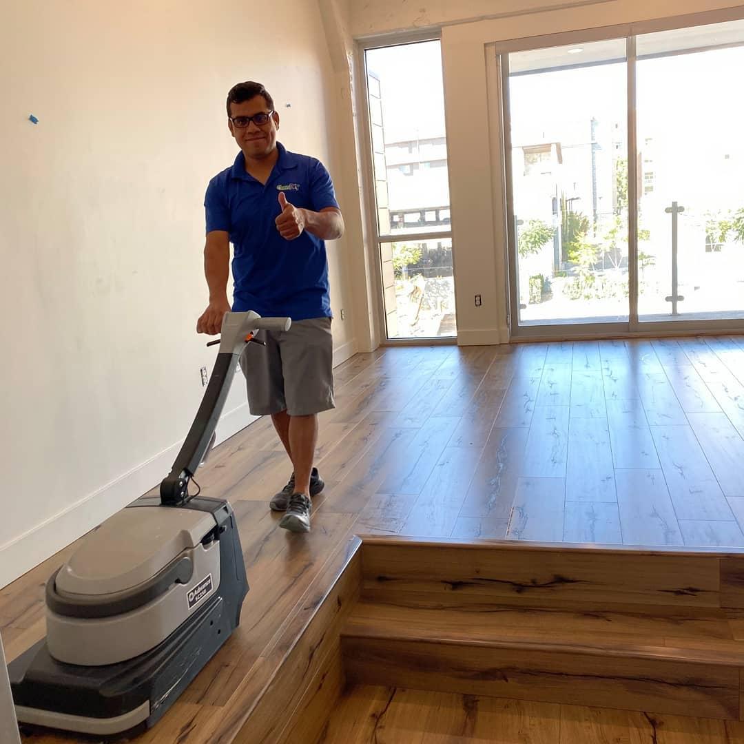 chem-dry tech performing wood floor cleaning in salt lake city